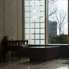 Chair near the windows in the Library Atrium