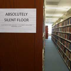 Quiet sign and book stacks on Floor 5
